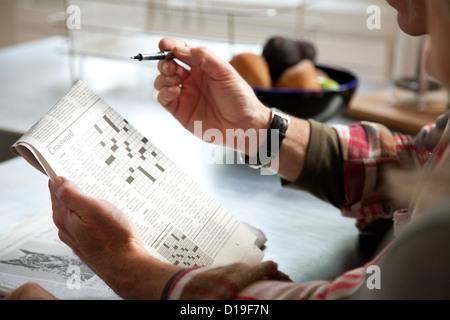 Couple doing crossword - Stock Photo