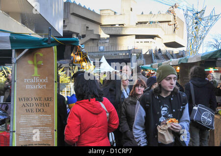 Southbank, London, UK. 16th December 2012. The market is filled with people buying and eating and drinking produce, - Stock Photo