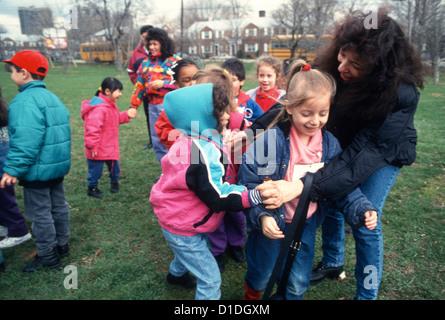 Brooklyn Pubic School kindergarten class having fun in the park on an outing. - Stock Photo