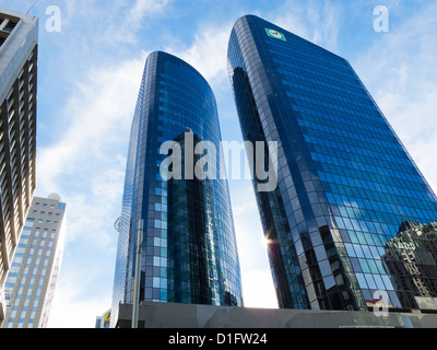 Tall buildings in Auckland city. Viewed from Queen St. Post modern architecture. North Island, New Zealand - Stock Photo