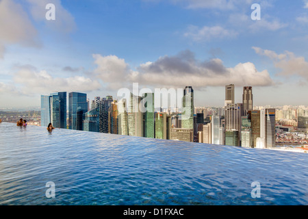 Sands SkyPark infinity swimming pool on the 57th floor of Marina Bay Sands Hotel, Marina Bay, Singapore, Southeast - Stock Photo