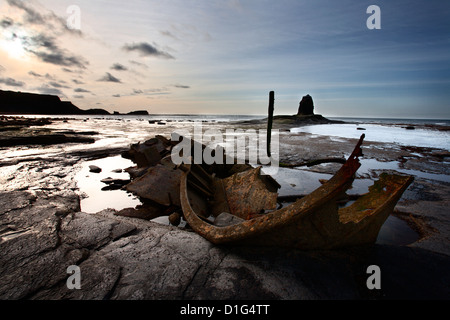 Old wreck and Black Nab at Saltwick Bay, near Whitby, North Yorkshire, Yorkshire, England, United Kingdom, Europe - Stock Photo
