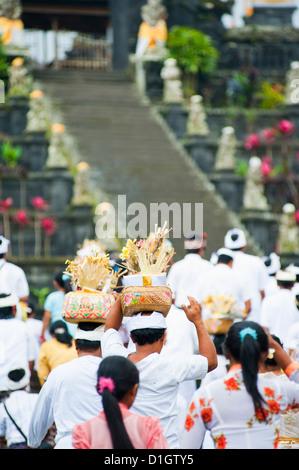 Hindu people at a religious Hindu festival at Besakih Temple (Pura Besakih), Bali, Indonesia, Southeast Asia, Asia - Stock Photo