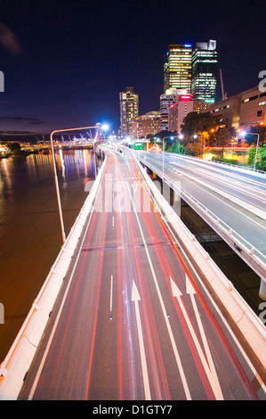 Car light trails at night on a highway in Brisbane, Queensland, Australia, Pacific - Stockfoto