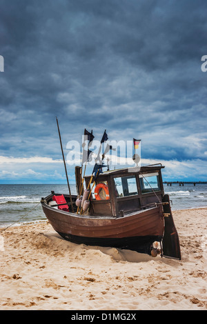 One Fishing boat at the beach of the Baltic Sea, Ahlbeck, Usedom Island, Mecklenburg-Western Pomerania, Germany, - Stock Photo