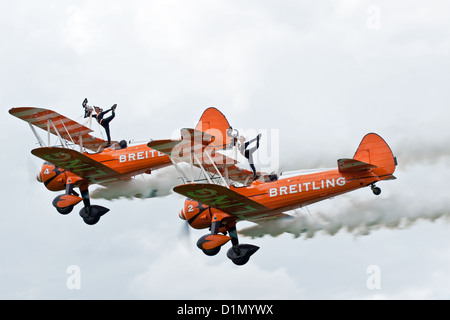 The Breiting Team wing-walkers pose for the crowd at the Sywell Air Show - Stock Photo