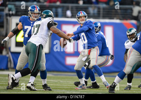New Jersey, USA. 30 December 2012: New York Giants quarterback Eli Manning (10) attempts a pass during a week 17 - Stock Photo