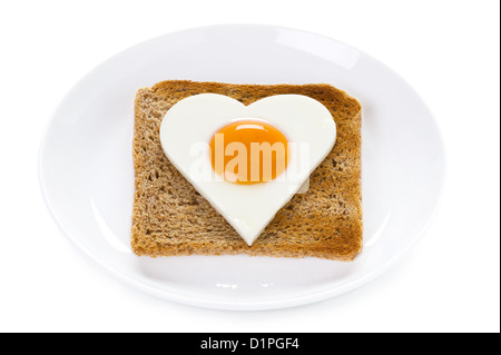 heart shaped cooked egg on toast isolated on white background. valentine or healthy heart cholesterol concept - Stock Photo