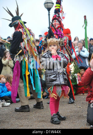 Bankside, London, UK. 6th January 2013. A small girl takes part as The Mummers perform the Mummers Play. Twelfth - Stock Photo