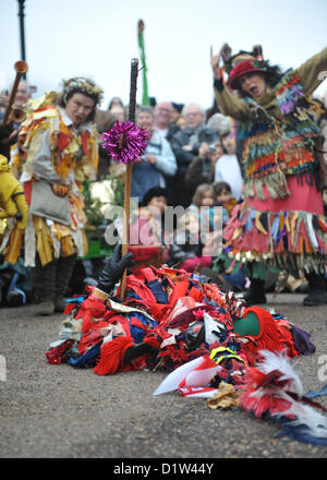 Bankside, London, UK. 6th January 2013. The crowd watch as the Mummers perform 'The Mummers Play', with St George - Stock Photo