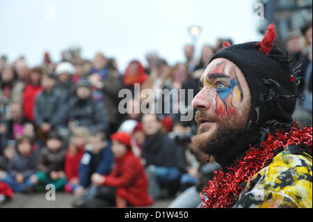 Bankside, London, UK. 6th January 2013. The crowd watch as the Mummers perform 'The Mummers Play', with 'Beelezebub' - Stock Photo