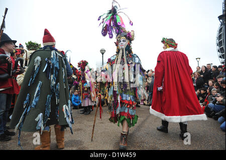 Bankside, London, UK. 6th January 2013. The crowd watch as the Mummers perform 'The Mummers Play'. Twelfth Night - Stock Photo