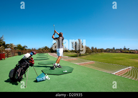 Golf player at the golf course, Maspalomas, Gran Canaria, Canary Islands, Spain, Europe - Stock Photo