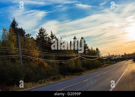 Rural highway, Maine, USA - Stock Photo