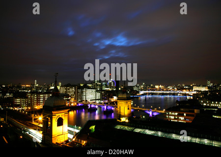 Skyline view of the River Thames beyond Cannon Street Railway Station, City of London, UK - Stock Photo