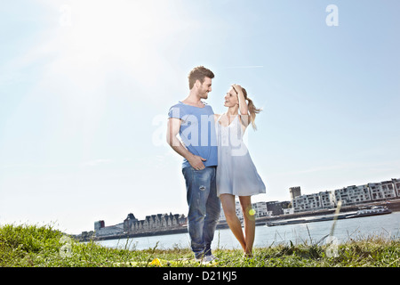 Germany, Cologne, Couple looking at each other, smiling - Stock Photo