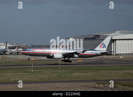 American Airlines Passenger Aircraft landing at London Heathrow Airport - Stock Photo