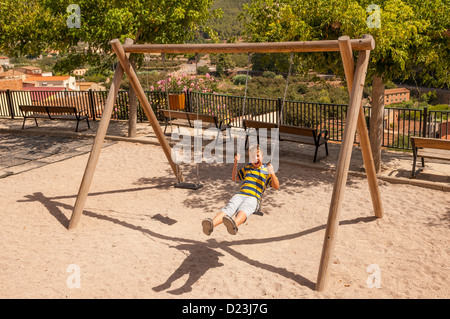 Children playing on swings in park stock photo royalty for Swingvillage