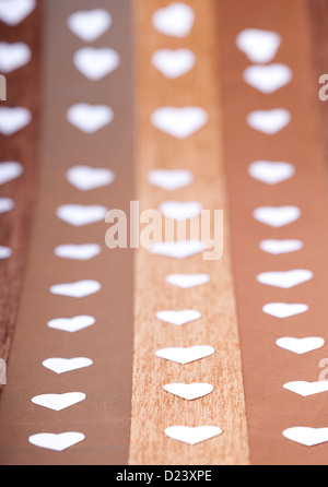 Heart shape papper cuts on a background studio shot - Stockfoto