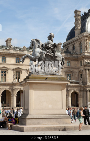 Equestrian statue of Louis XIV in front of the Louvre museum in Paris, France - Stock Photo