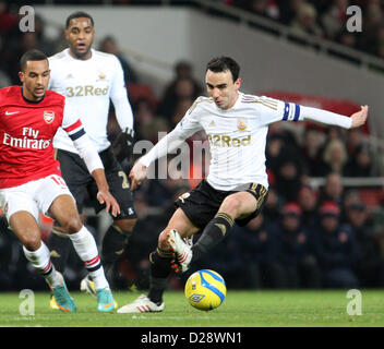 London, UK. 16th January 2013. Leon Britton of Swansea City and Theo Walcott of Arsenal in  action during The FA - Stock Photo