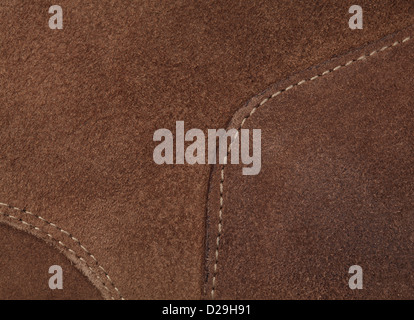 Close up photo of light brown leather in high resolution. Three pieces of nubuck stitched with light thread. - Stock Photo