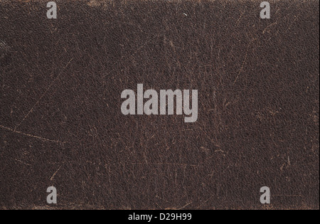 Close up photo of dark brown scratched leather in high resolution - Stock Photo