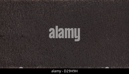 Close up photo of dark brown leather in high resolution - Stock Photo