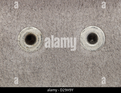 Close up photo of white leather with two rivets in high resolution. - Stock Photo