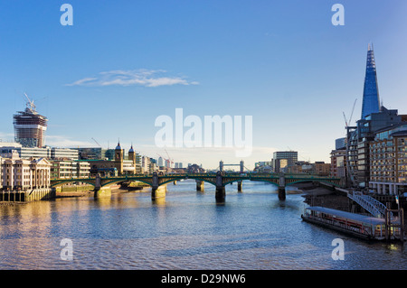 Southwark bridge over The Thames River and the city of London, England, UK - with the Shard - Stock Photo