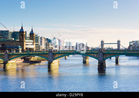 Southwark Bridge over the River Thames, London, England, UK - with Tower Bridge in the background - Stock Photo