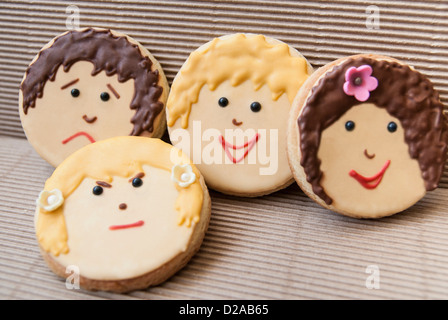 Cookies decorated with faces - Stockfoto