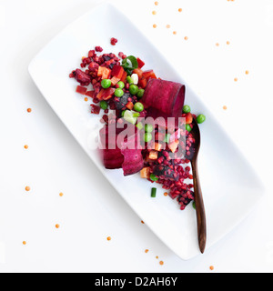 Plate of pea and pomegranate salad - Stock Photo