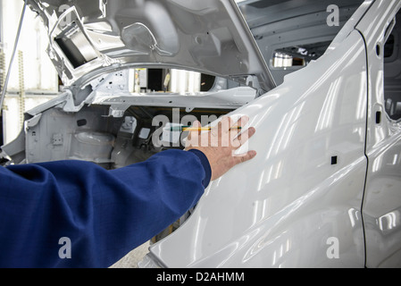close up of man checking car engine oil level on dipstick. Black Bedroom Furniture Sets. Home Design Ideas
