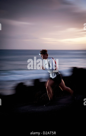 Blurred view of runner on rocky trail - Stock Photo