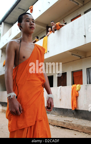 Fang, Thailand, young novice listens music with headphones - Stock Photo