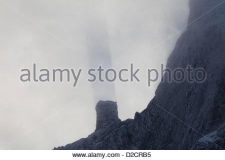 Shadow from the peak Stabben in the Romsdalen valley, Møre og Romsdal, Norway. - Stock Photo