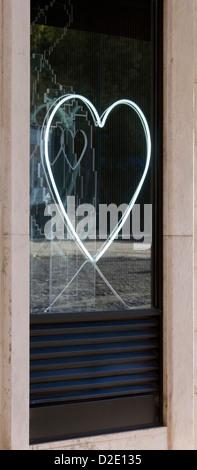 A neon heart in a Lisbon shop window - Stock Photo