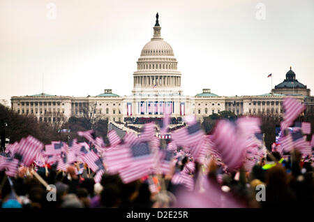 People wave American flags on the National Mall during the 57th Presidential Inauguration January 21, 2013 in Washington, - Stock Photo
