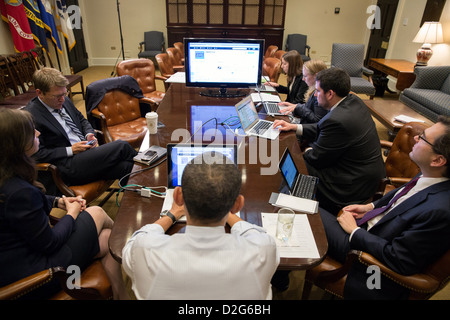 President Barack Obama participates in a live Twitter question and answer session in the Roosevelt Room of the White - Stock Photo