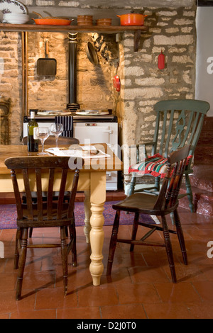kitchen old stone fireplace and aga cooker stock photo