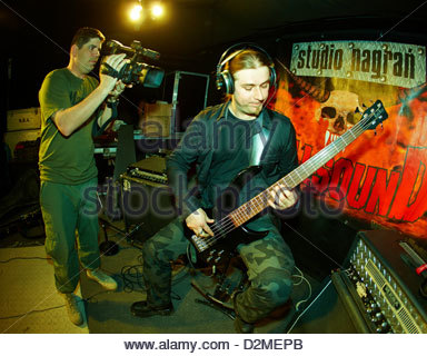 Base guitarist rehearsal in the studio - Stock Photo