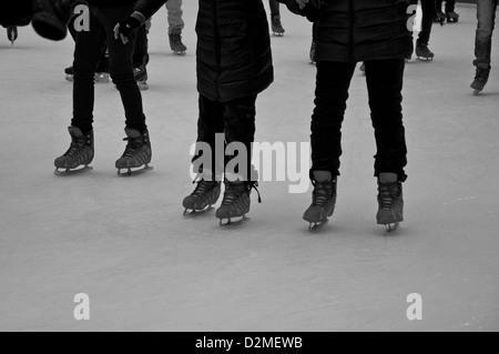 Ice skaters Bryant park New York - Stock Photo