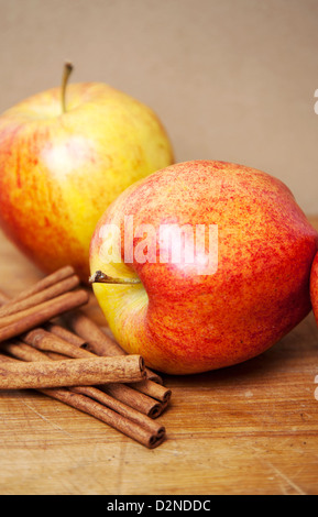 Apples and cinnamon sticks - Stock Photo