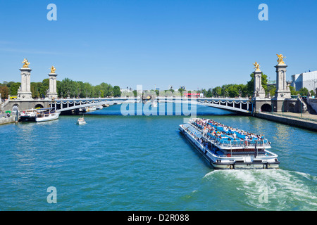 River Seine Cruise boat, Bateaux Mouches and the Pont Alexandre III Bridge, Paris, France, Europe - Stock Photo