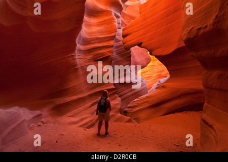 Female tourist hiker and Sandstone Rock formations, Lower Antelope Canyon, Page, Arizona, USA - Stock Photo