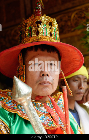 A guard, the queens and the ministers at the biggest Nat ritual in Taungbyon, Mandalay Division, Burma, Myanmar - Stock Photo