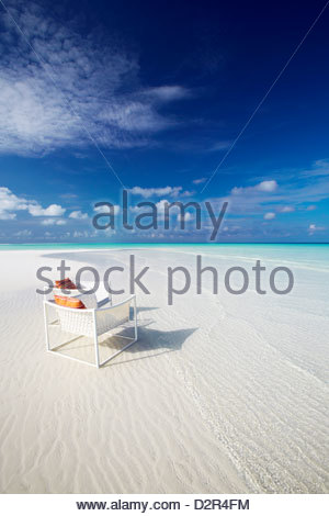Deck chairs on tropical beach, Maldives, Indian Ocean, Asia - Stock Photo