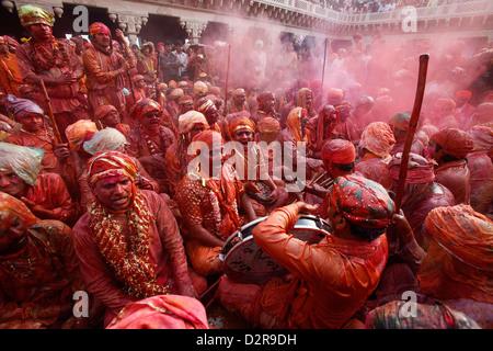 Barsana villagers celebrating Holi in Nandgaon, Uttar Pradesh, India, Asia - Stock Photo
