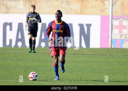 BARCELONA, SPAIN - MAR 12: Backary Mendes plays with F.C Barcelona youth team against L'Hospitalet on March 12, - Stock Photo